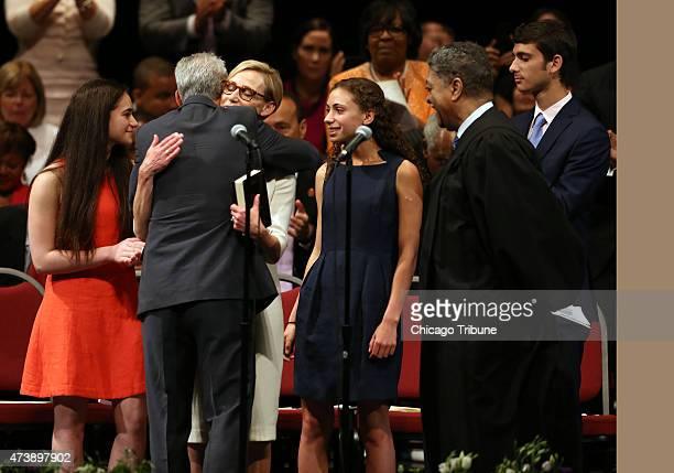 Chicago Mayor Rahm Emanuel hugs wife Amy Rule at his second inauguration event at the Chicago Theatre on Monday May 18 2015 in Chicago Their children...