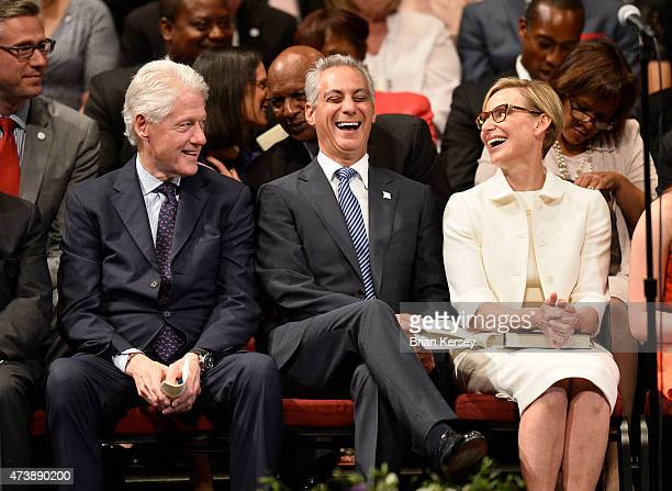 Chicago Mayor Rahm Emanuel laughs with his wife Amy Rule and former U.S. President Bill Clinton as he is introduced at the inauguration ceremony for...