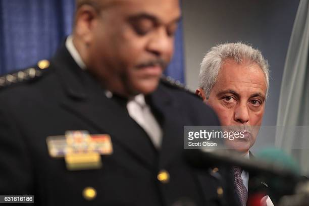 Chicago Mayor Rahm Emanuel listens as Police Superintendent Eddie Johnson speaks at a press conference called by US Attorney General Loretta Lynch on...