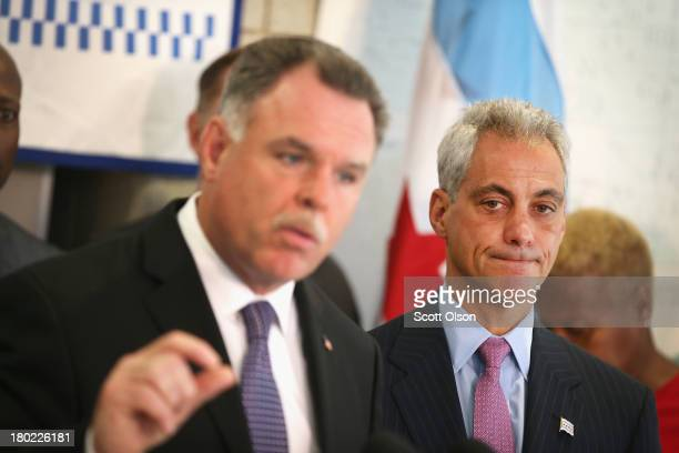 Chicago Mayor Rahm Emanuel listens as Police Superintendent Garry McCarthy speaks at a press conference on September 10 2013 in Chicago Illinois...