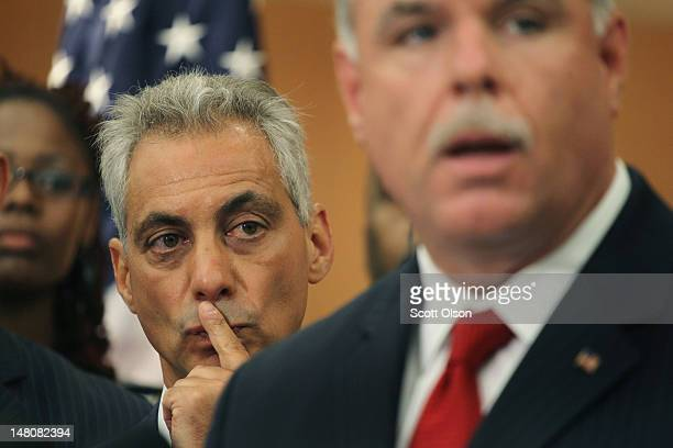 Chicago Mayor Rahm Emanuel listens at a press conference as Police Superintendent Garry McCarthy speaks in the Englewood neighborhood on July 9 2012...