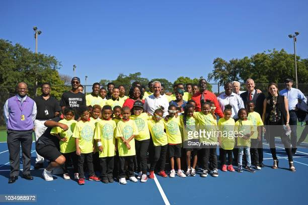 Chicago Mayor Rahm Emanuel poses with local students and community members during the Laver Cup Legacy Court Ceremony at Garfield Park on September...