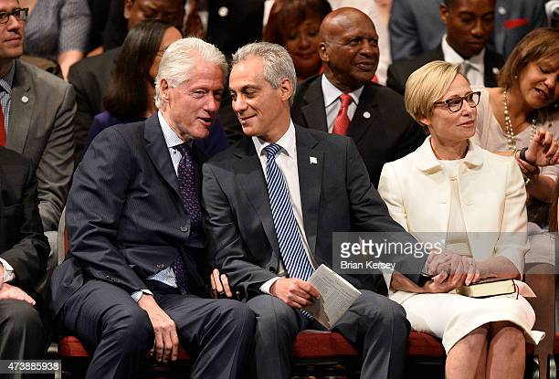 Chicago Mayor Rahm Emanuel sits with his wife Amy Rule and former US President Bill Clinton as he is introduced at the inauguration ceremony for his...