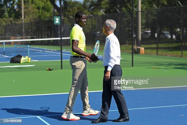 Chicago Mayor Rahm Emanuel speaks with local students during the Laver Cup Legacy Court Ceremony at Garfield Park on September 17 2018 in Chicago...