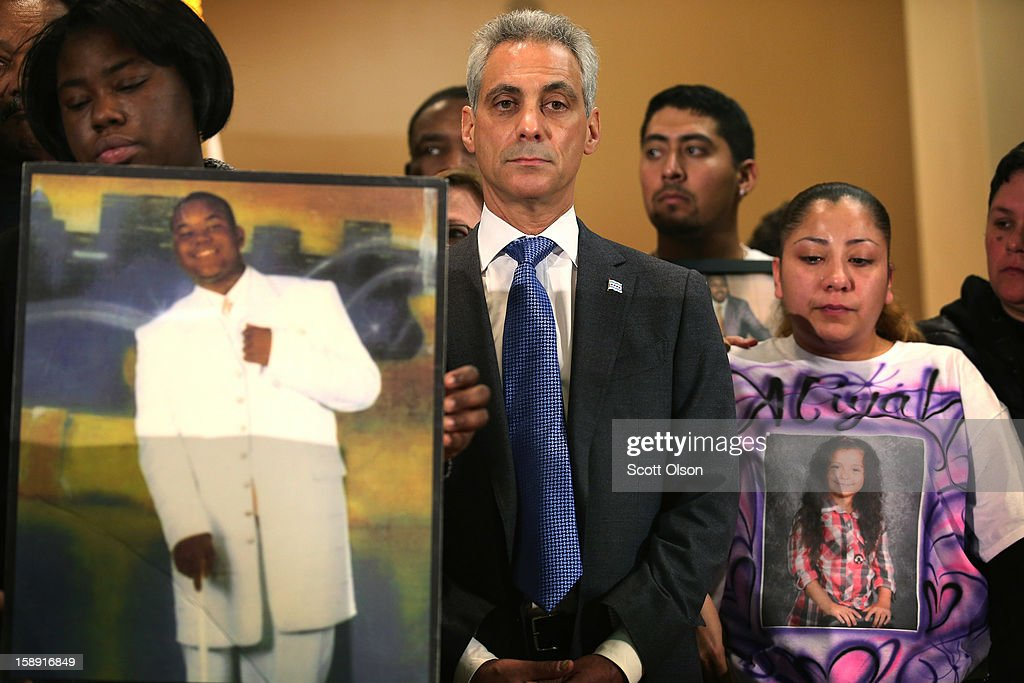 Chicago Mayor Rahm Emanuel stands with family members of murder victims and community leaders as he listens to a speaker during a press conference at St. Sabina Church January 3, 2013 in Chicago, Illinois. The press conference was called to make a plea for stronger gun regulations including a ban on assault weapons. In 2012 Chicago reported 506 murders. In the first 3 days of 2013 Chicago has had 5 murders.