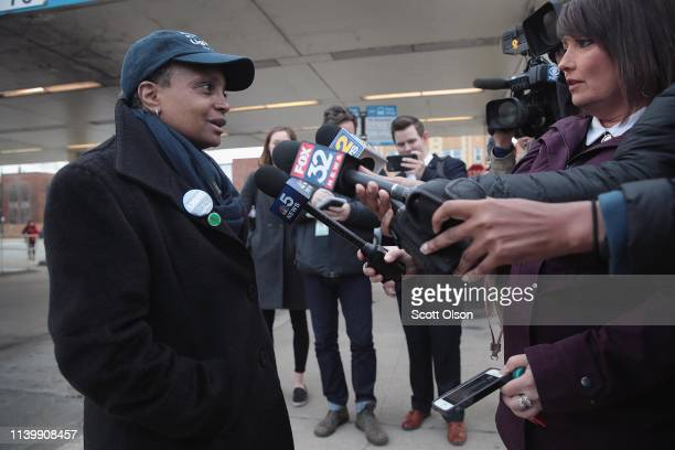 Chicago mayoral candidate Lori Lightfoot speaks to the press before greeting commuters at an L station in the Logan Square neighborhood on April 02...