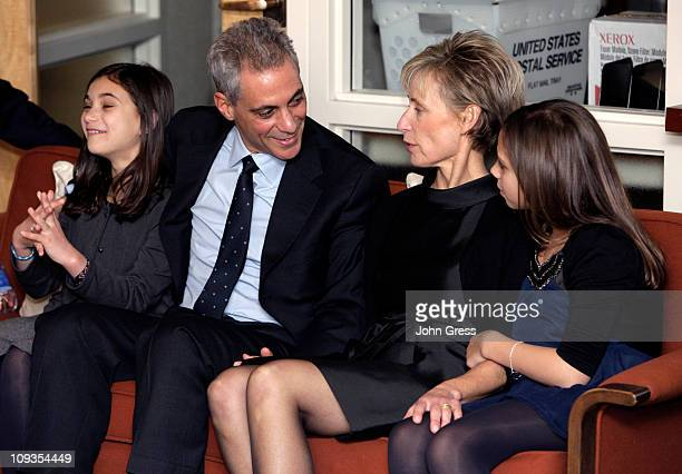 Chicago Mayoral candidate Rahm Emanuel kisses his daugher Leah as his wife Amy Rule and his daughter Ilana watch election results February 22 2011 in...