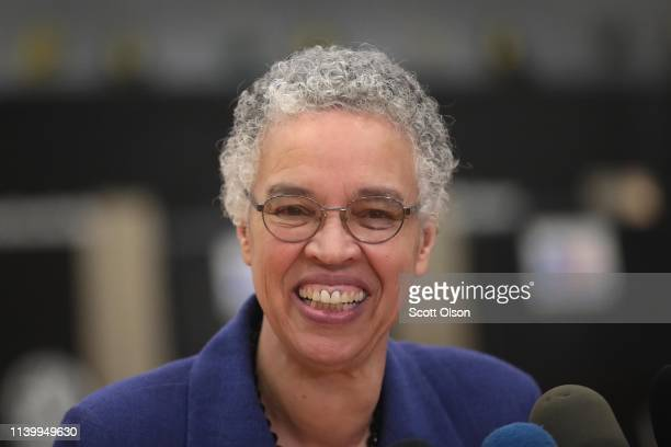 Chicago mayoral candidate Toni Preckwinkle talks to reporters at her polling place in the Kenwood neighborhood after casting her ballot on April 02...