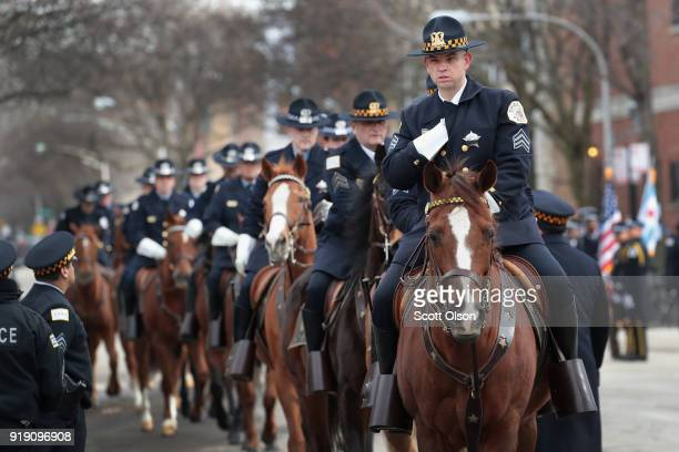 Chicago mounted police await the remains of Commander Paul Bauer outside of the Nativity of Our Lord church in the Bridgeport neighborhood on...