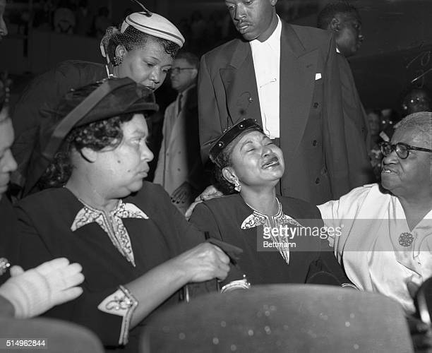 Mrs Mamie Bradley mother of Emmett Till who was found slain in Mississippi where he was on vacation is near hysteria as she attends funeral services...