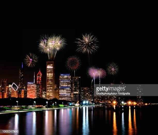 Chicago night skyline with fireworks, Usa.