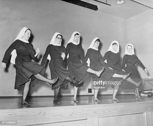 Nuns rehearse for their show business debut by forming a chorus line and going thru shoeless routine They will perform in the auditorium of the...