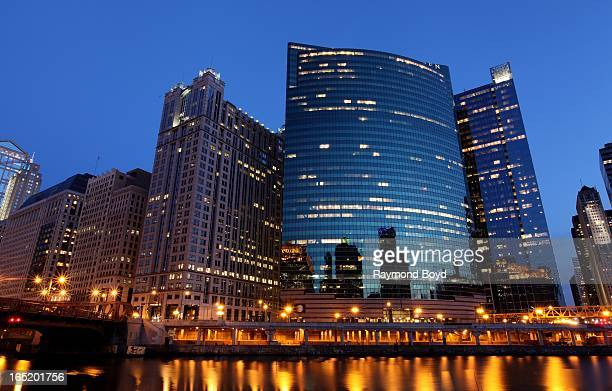 Chicago office buildings at dusk on West Wacker Drive along the Chicago River in Chicago Illinois on MARCH 28 2013
