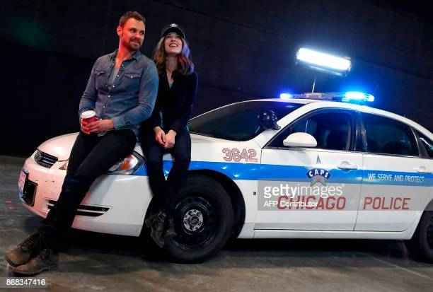 Chicago PD cast members Patrick John Flueger speaks with fellow cast mate Marina Squerciati during the behind the scenes show at the 3rd Annual...
