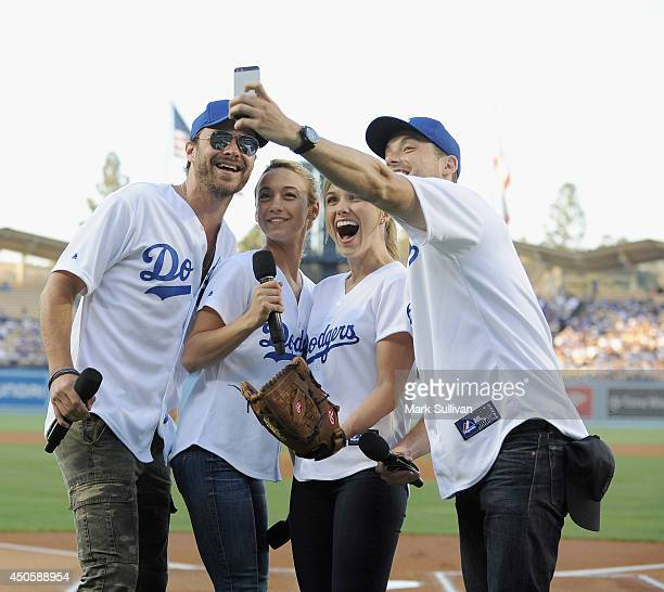 Chicago PD cast members Patrick John Flueger Stella Maeve Sophia Bush and Jesse Lee Soffer take a photo before the game between the Arizona...