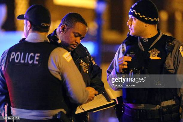 A Chicago Police Department detective center speaks with two officers on Saturday Feb 18 2017 while investigating the scene of a shooting in the 7300...