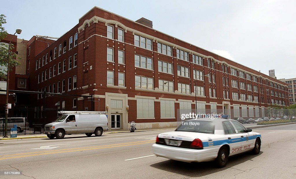 A Chicago police department patrol car drives past the front of the Wm. Wrigley Jr. building June 30, 2005 in Chicago, Illinois. Chicago-based Wm. Wrigley Jr. has said it will close this 94-year-old factory that produces the company's chewing gum, effecting close to 600 workers, after its acquisition of Kraft Foods' Life Savers and Altoids brands June 29.