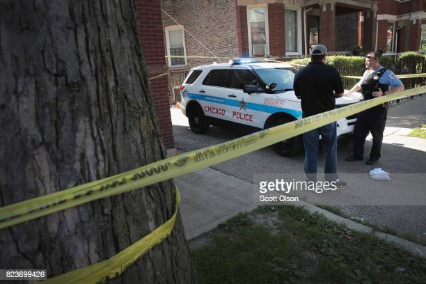 Chicago Police guard evidence near a murder scene in the Humboldt Park neighborhood on July 27 2017 in Chicago Illinois At least 400 murders have...