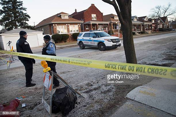 Chicago police guard the perimeter of a crime scene where six people were found slain on the city's Southwest Side on February 4 2016 in Chicago...