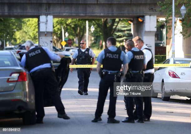 Chicago police investigate the scene of a shooting near 59th and South Peoria streets in the Englewood neighborhood on June 1 2017 in Chicago