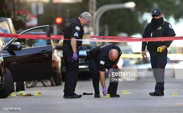 Chicago police investigate the scene of a shooting that killed rapper Carlton Weekly known as FBG Duck and wounded two others at 70 E Oak St in...