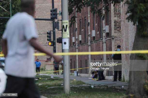 Chicago police investigate the scene where multiple people were shot at the intersection of West Washington Boulevard and North LeClaire Avenue in...