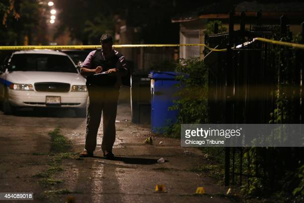 Chicago police investigate the scene where three people were shot including a 33yearold man who died in the early morning hours on Sunday Aug 24 in...