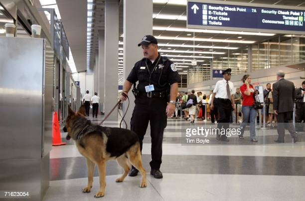 Chicago police officer George Hickey and his dog Al patrol O'Hare International Airport August 10 2006 in Chicago Illinois British authorities have...