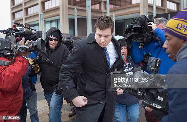 Chicago police officer Jason Van Dyke leaves the Criminal Courts Building after pleading not guilty to firstdegree murder charges related to the...