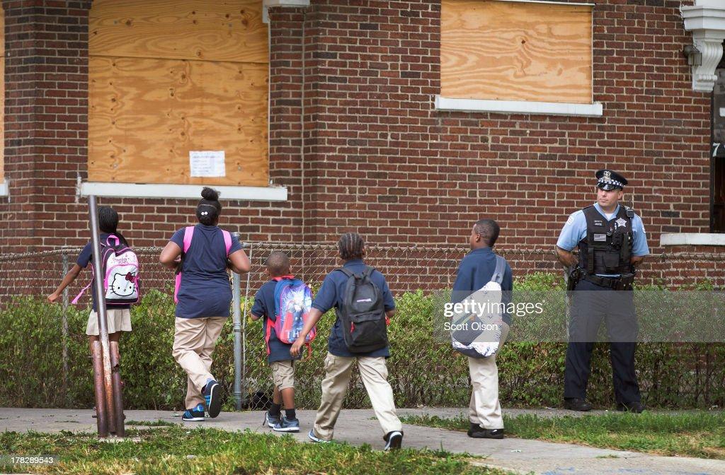 Chicago Police And Neighborhood Officials Escort Children To School : News Photo