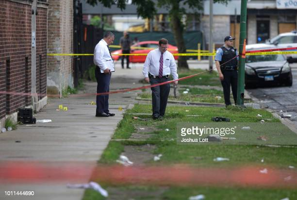 Chicago Police officers and detectives investigate a shooting where multiple people were shot on Sunday August 5 2018 in Chicago Illinois In the last...