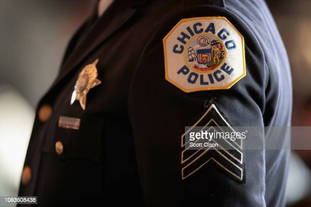 Chicago police officers attend a graduation and promotion ceremony at Navy Pier on November 19 2018 in Chicago Illinois More than 350 officers were...