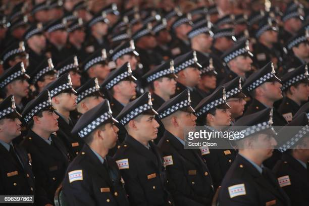 Chicago police officers attend a graduation and promotion ceremony in the Grand Ballroom on Navy Pier on June 15 2017 in Chicago Illinois Several...