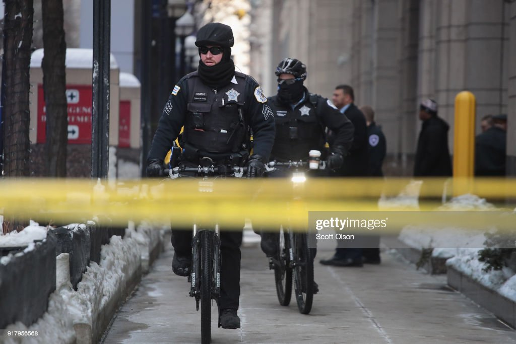Chicago police officers gather outside Northwestern Memorial Hospital after learning of the death of Cmdr. Paul Bauer on February 13, 2018 in Chicago, Illinois. Bauer, who was downtown leaving training session, was shot after trying to help stop a man being pursued by tactical officers.
