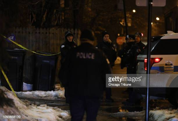 Chicago police officers investigate the fatal shooting death of an offduty officer in an alley just west of the 900 block of South Bell early Sunday...