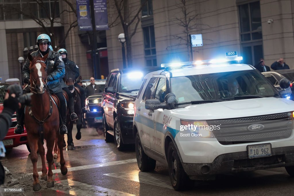 Chicago police officers join in the procession as an ambulance carrying the remains of Cmdr. Paul Bauer leaves Northwestern Memorial Hospital on February 13, 2018 in Chicago, Illinois. Bauer, who was downtown leaving a training session, was shot while trying to help stop a man being pursued by tactical officers.
