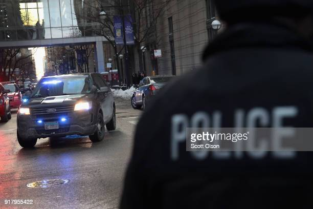 Chicago police officers join in the procession behind the ambulance carrying the remains of Cmdr Paul Bauer as it leaves Northwestern Memorial...