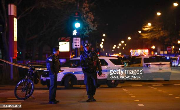 Chicago Police officers monitor the area outside of the Chicago Mercy Hospital where a gunman opened fire in Chicago on November 19 2018 An argument...