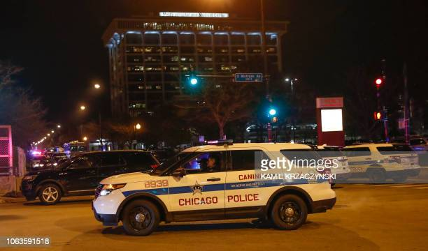 Chicago Police officers monitor the area outside of the Chicago Mercy Hospital where a gunman opened fire in Chicago on November 19, 2018. - An...