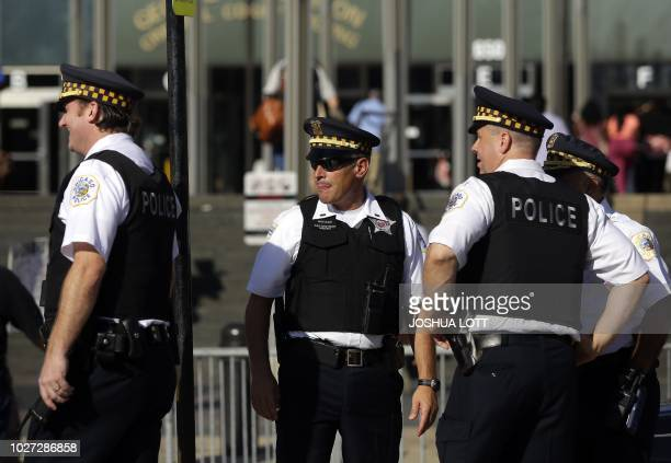 Chicago police officers stand outside the Leighton Criminal Courts Building as jury selection begins in the murder trial for Chicago police officer...