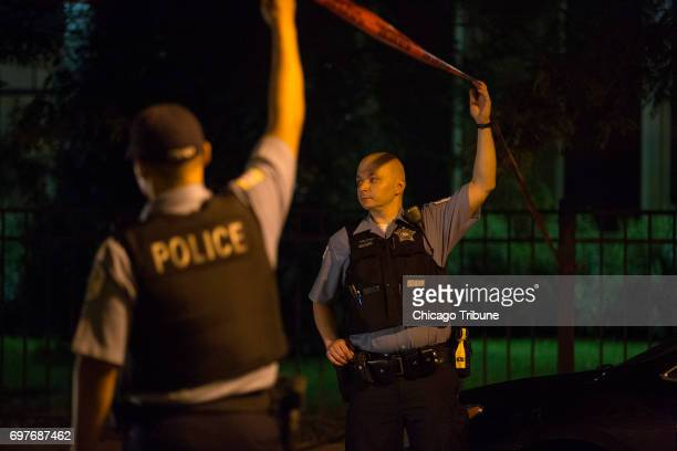 Chicago Police officers work at the scene where a man and woman both in their 60s were found stabbed to death in a home by a family member in the...