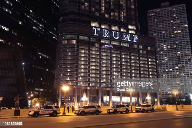 Chicago Police park across the Chicago River from Trump Tower as the city continues increased security measures which include raising the bridges...