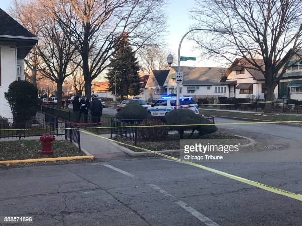 Chicago police respond to a fatal shooting in the West Side's Austin neighborhood Dec 7 2017 in Chicago