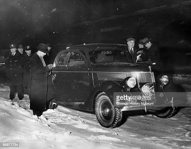 Chicago police search through Jack McGurn's car for any clues to his murder in a bowling alley at 805 Milwaukee Avenue Chicago 1936