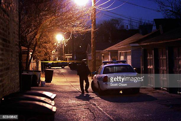 Chicago Police secure the area around a residence on the city's northwest side believed to be the home of suspected murderer Bart Ross March 10 2005...