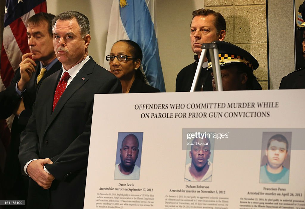 Chicago Police Superintendant Garry McCarthy (2nd from left) listens to speakers during a press conference he called with Mayor Rahm Emanuel to promote a plan to increase mandatory minimum sentencing for serious gun crimes in an effort to combat the city's growing gun violence problem on February 11, 2013 in Chicago, Illinois. President Barack Obama is expected to speak about the city's growing gun violence problem during a visit to Chicago on Friday. Last year the city had more than 500 murders.