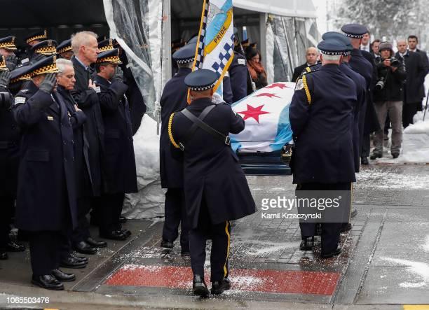 Chicago Police Superintendent Eddie Johnson , Chicago Mayor Rahm Emanuel and Illinois Governor Bruce Rauner salute as the casket of slain Chicago...