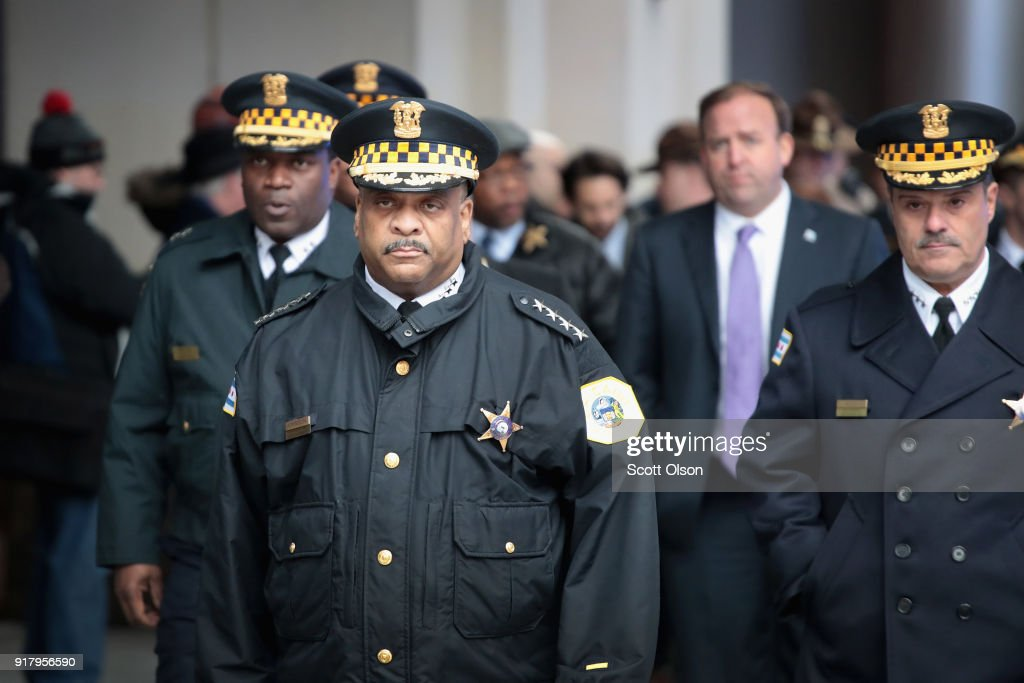 Chicago Police Superintendent Eddie Johnson (front) prepares to speak to the press outside Northwestern Memorial Hospital following the shooting death of Cmdr. Paul Bauer on February 13, 2018 in Chicago, Illinois. Bauer, who was downtown leaving training session, was shot after trying to help stop a man being pursued by tactical officers.