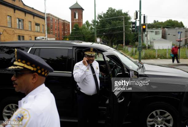 Chicago Police Superintendent Eddie Johnson speaks on his phone before addressing the reporters at a news conference about Chicago's weekend of gun...