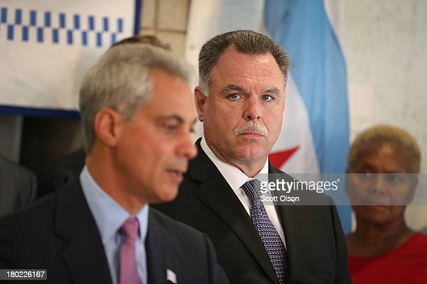 Chicago Police Superintendent Garry McCarthy listens as Chicago Mayor Rahm Emanuel speaks at a press conference on September 10 2013 in Chicago...